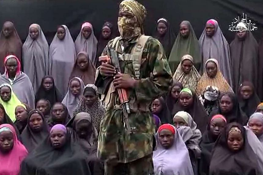 An image grab purportedly showing girls kidnapped by Boko Haram from Chibok, taken from a video released on Aug 14, 2016.