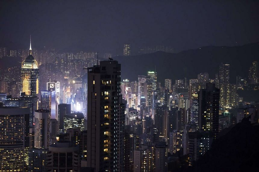 Residential and commercial buildings stand illuminated at night in Hong Kong on Nov 27, 2015.