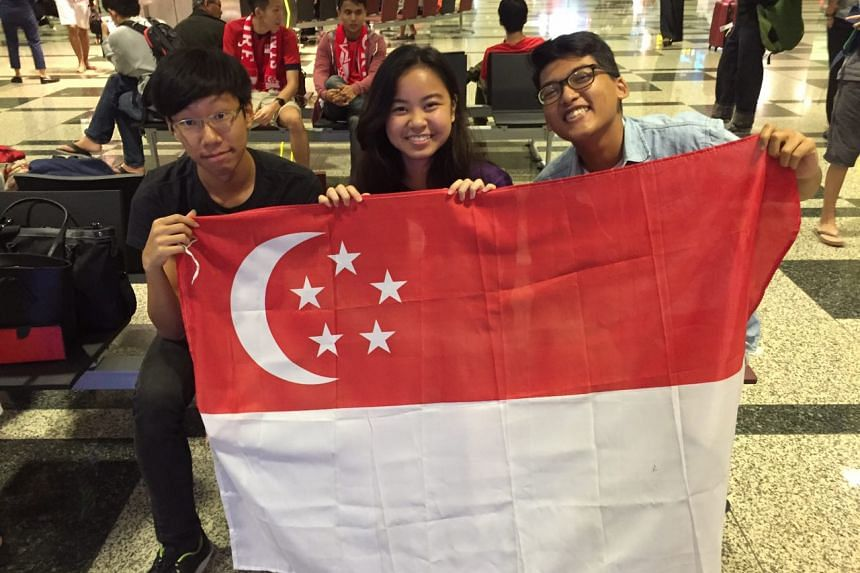 Students (from left) Makarios Tan, Tiah Jhan Rei, and Rudy Halim arrived at the airport after taking the last train at about 12.30am.