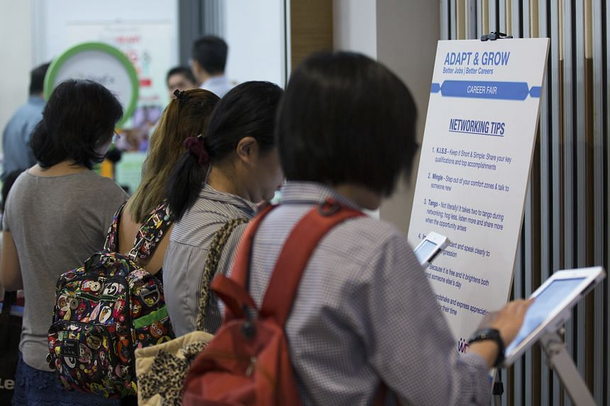 Visitors at a career fair oragnised by the Singapore Workforce Development Agency on June 14.