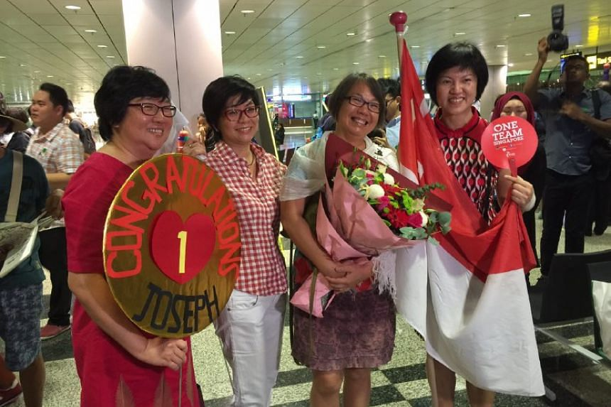 Fans at the arrival hall at Changi Airport on Aug 15.
