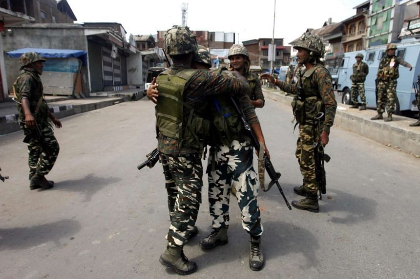 Indian paramilitary soldiers hug each other after a gunfight in the Nowhatta area of downtown of Srinagar, the summer capital of Indian Kashmir on Aug 15, 2016.