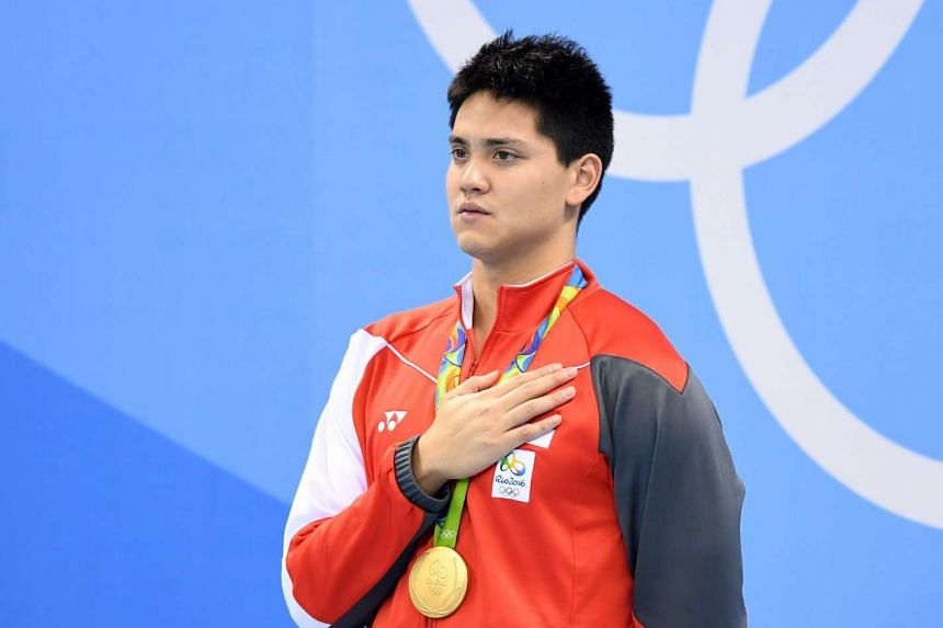 Joseph Schooling during the medal ceremony after his 100m butterfly victory.