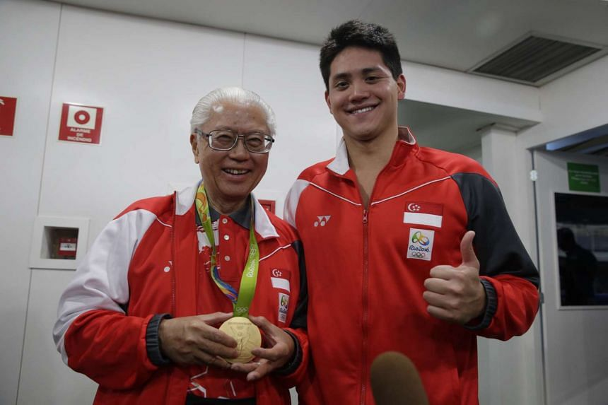 President Tony Tan Keng Yam wearing the gold medal won by Joseph Schooling of Singapore from the Rio 2016 Olympic Games men's 100m butterfly final at the Olympic Aquatics Stadium on Aug 12, 2016.