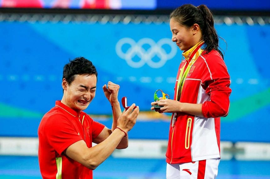He Zi receives a marriage proposal from Chinese diver Qin Kai after she won silver in the women's 3m springboard.