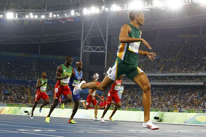 Wayde van Niekerk of South Africa wins the gold medal and sets a new world record for the men's 400m.