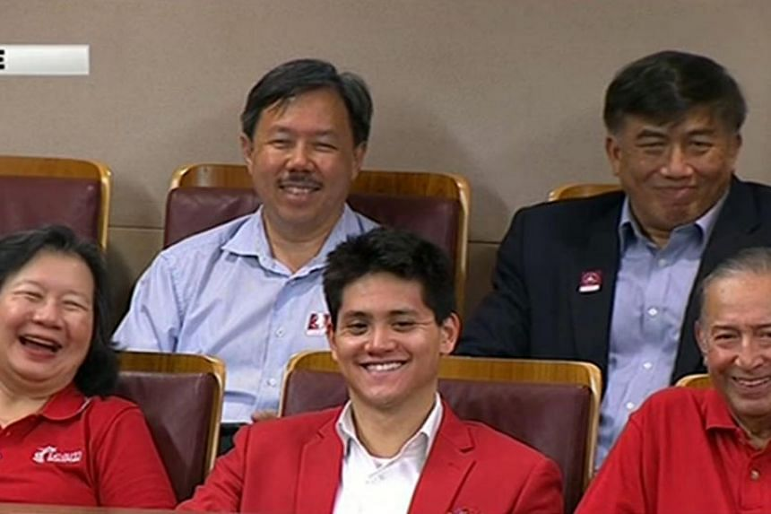 Singapore swimmer Joseph Schooling (centre) flanked by his parents, mother Mrs May Schooling and father Mr Colin Schooling, in Parliament on Monday (August 15).