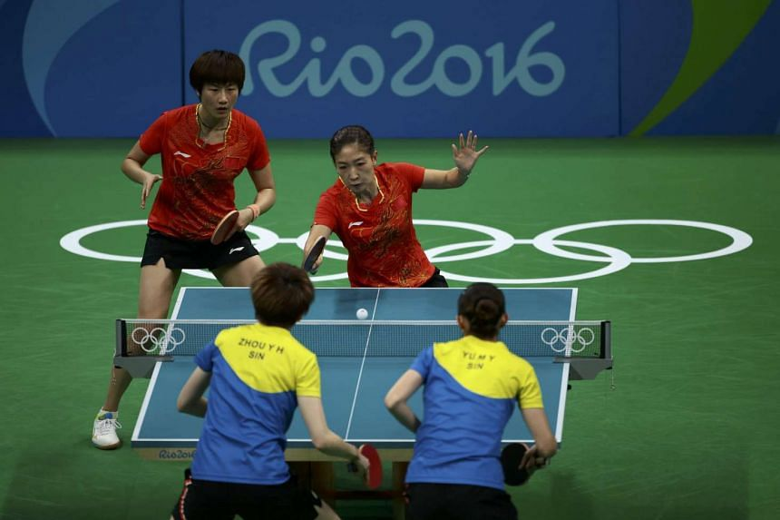 Zhou Yihan (bottom, left) and Yu Mengyu of Singapore in action against China's Ding Ning (top, left) and Liu Shiwen, on Aug 15, 2016.