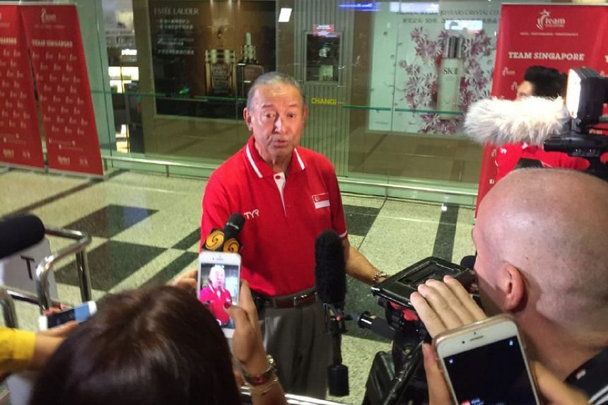 Colin Schooling speaking to the media while awaiting his son's arrival at Changi Airport on Aug 15.