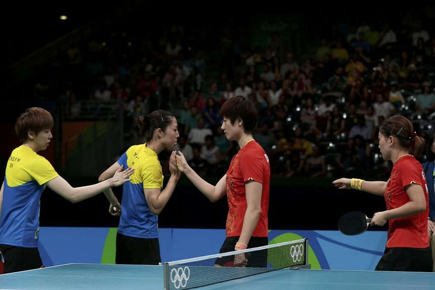 (From left) Zhou Yihan and Yu Mengyu congratulating China's Ding Ning and Liu Shiwen after their loss in the women's table tennis team finals, on Aug 15, 2016.