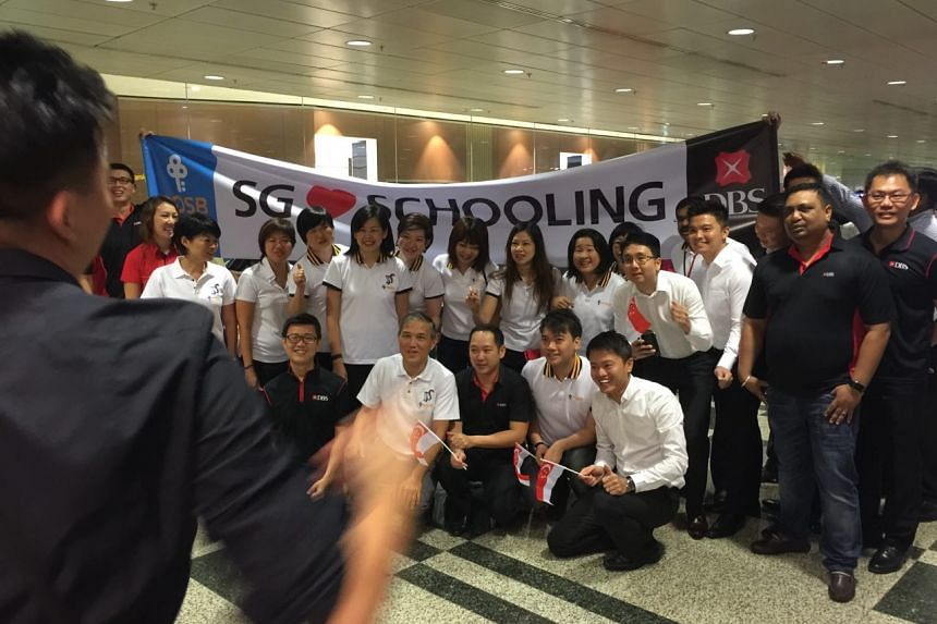 Supporters from DBS prepare for Joseph Schooling's arrival.