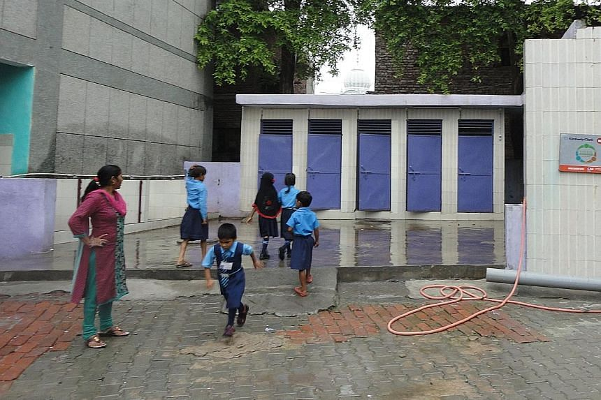 Pupils in Badarpur's SDMC Primary School can now use the school's toilets comfortably. The toilets were renovated six months ago by US firm Kimberly-Clark. Before the works, there were no lights in the cubicles and some doors would not close.