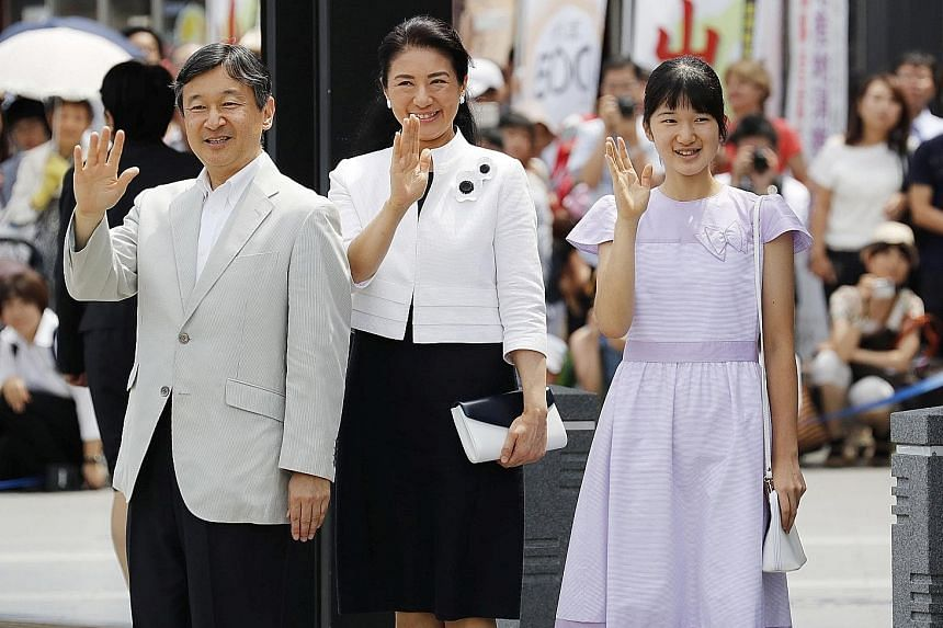 Crown Prince Naruhito, his wife Crown Princess Masako and their daughter Princess Aiko waving as they arrived at a train station in Matsumoto, Nagano prefecture, last Wednesday.