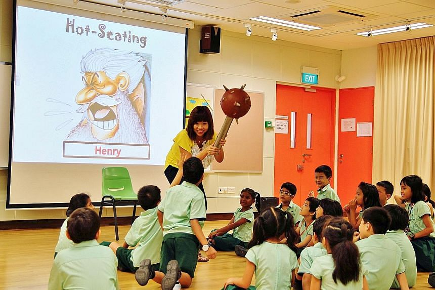 A teacher and her pupils role-playing during a process drama lesson at Farrer Park Primary School.