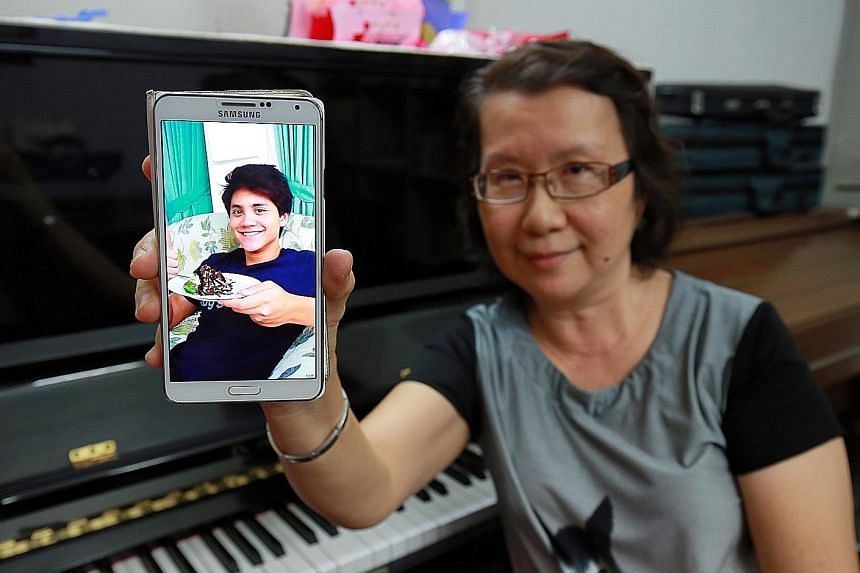 Ms Yim with a photo of her nephew. The music teacher said his talent and discipline was visible from a young age and he never missed a swim even on holiday in Ipoh as a child. Although the whole family was not able to be in Rio de Janeiro to cheer hi