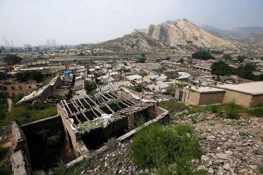 Abandoned houses on sinking land near a coal mine in Datong, Shanxi province, where the authorities plan to relocate 655,000 residents by the end of next year, at an estimated cost of $3.2 billion.