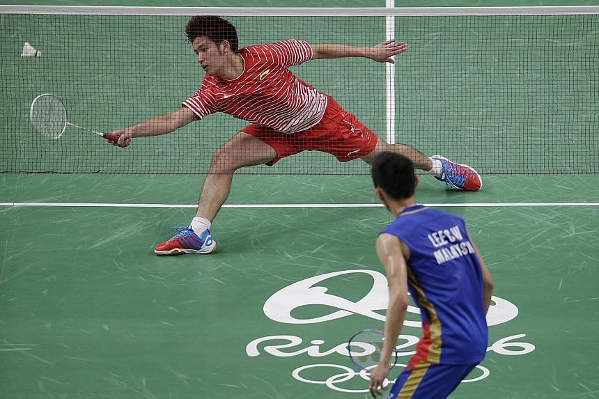 Derek Wong failing to return a shot against Malaysia's Lee Chong Wei during their Group A tie yesterday. The Singaporean shuttler fell to the world No. 1 in straight games, losing 18-21, 8-21, before hinting at possible retirement.