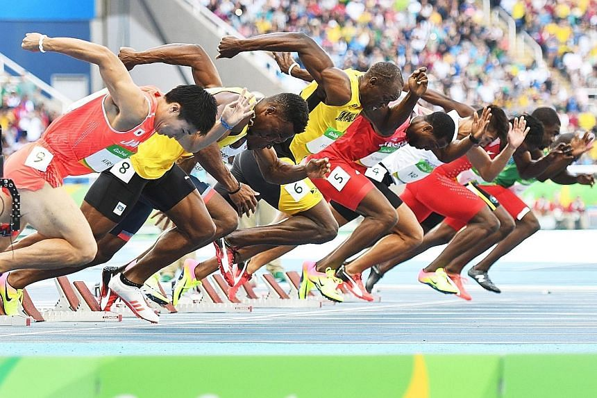 Jamaica's Usain Bolt (fourth from left) on his way to winning his first-round 100m heat at the Olympic Stadium. He is aiming to win a third straight gold in the event in this morning's final.
