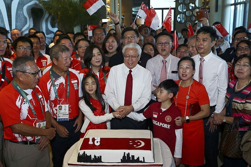 Front row from left: Singapore's Olympic chef de mission Low Teo Ping, International Olympic Committee executive board member Ng Ser Miang and President Tony Tan celebrating Singapore's 51st birthday with the Olympic athletes and other guests at the