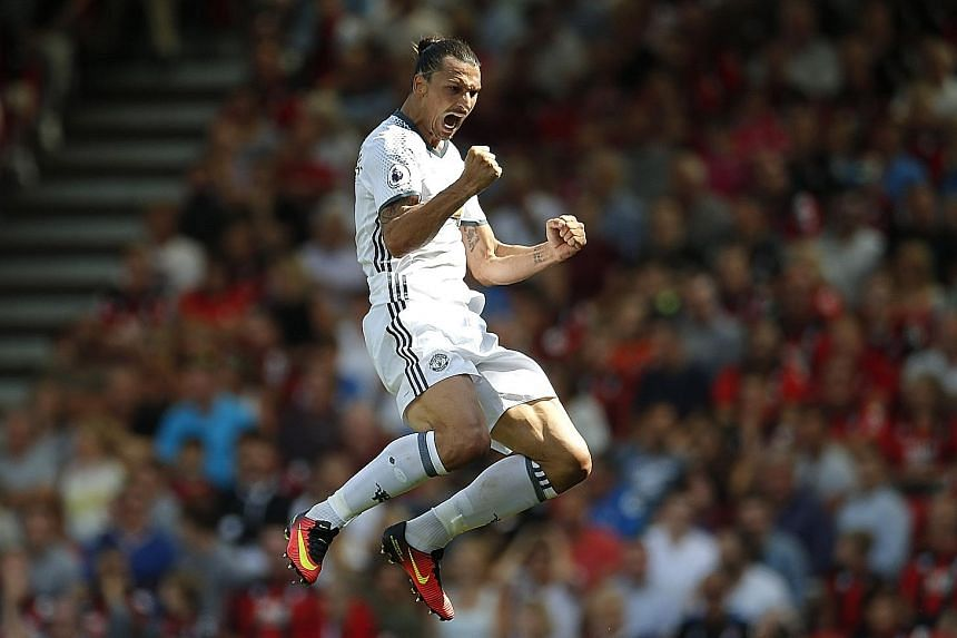 Manchester United striker Zlatan Ibrahimovic celebrating after marking his Premier League debut by scoring his side's third goal in their 3-1 win over Bournemouth.