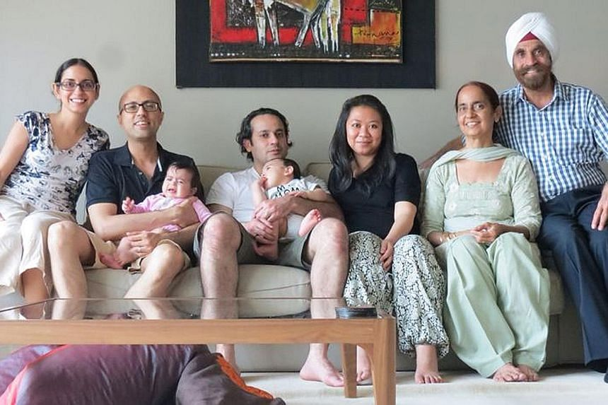 Mr Nagpal and his wife Pushpinder, with (from left) daughter Parveen, son-in-law Bhubhindar Singh Bhandal (holding granddaughter), son Randeep (with grandson in arms) and daughter-in-law Yuhana.