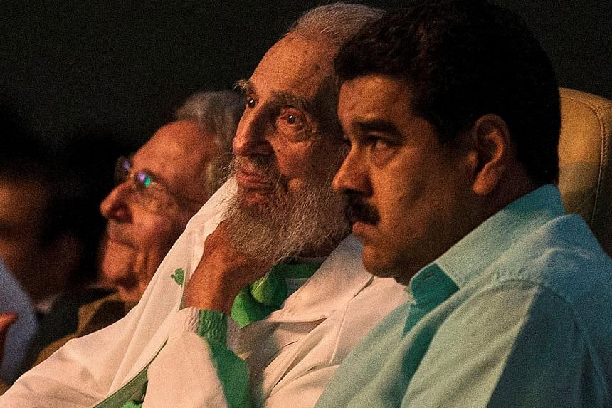 Mr Fidel Castro (centre) with Cuban President Raul Castro (left) and Venezuelan leader Nicolas Maduro at a gala for his birthday in Havana.