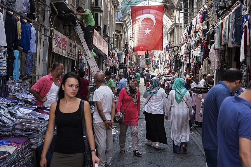 Shoppers browsing in an arcade in the Mahmutpasa district of Istanbul, Turkey, last week. Despite global perceptions, there is no disruption to daily life there. Only critical buildings and the airport have beefed up security checks.