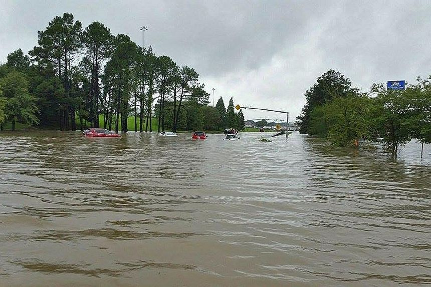 "A flooded road in Denham Springs, Louisiana. The National Weather Service described the flooding in the state as ""catastrophic""."