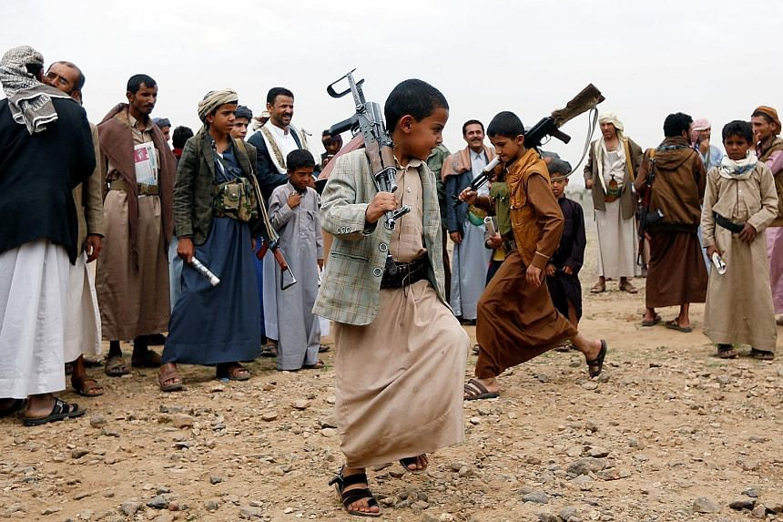 Armed boys performing the traditional Baraa dance at a tribal gathering held by tribesmen loyal to the Huthi movement. Unicef has warned that with the intensification in violence across Yemen in the past week, the number of children killed and injure