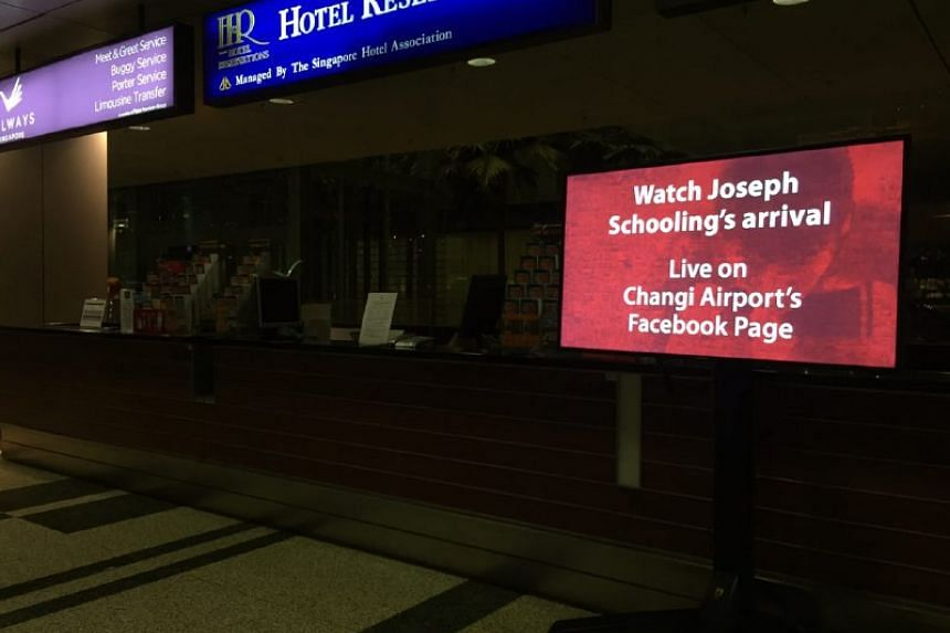 Changi Airport advertises its live coverage of Joseph Schooling's arrival.