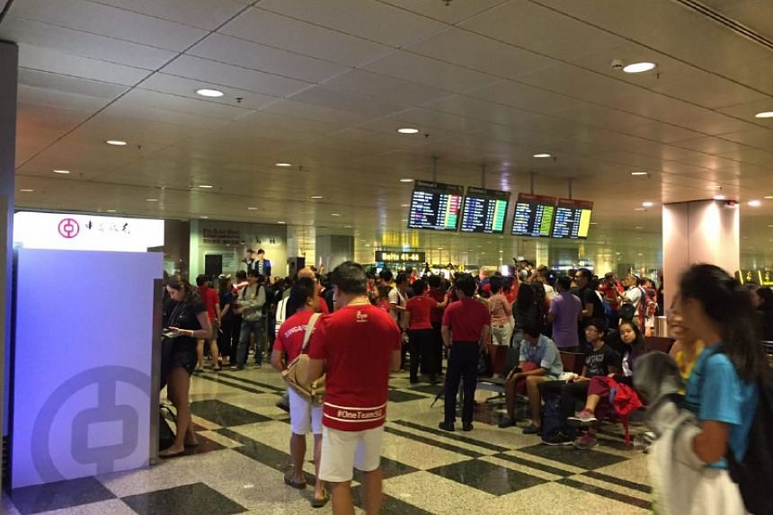 Fans awaiting Joseph Schooling's arrival at Changi Airport on Aug 15.