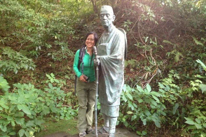 Travel writer Lee Siew Hua stops for a photo next to a statue of 17th century poet Matsuo Basho.