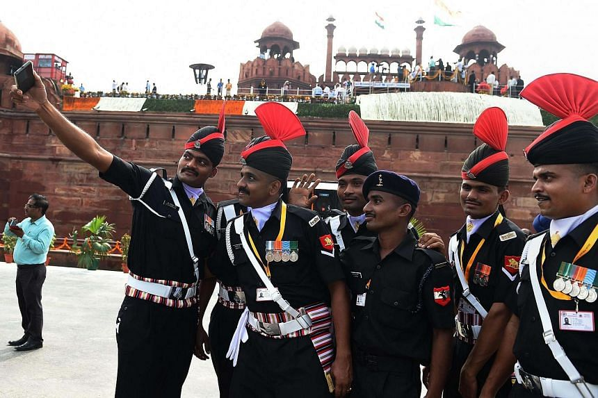 Indian Army personnel pose for a selfie after Independence Day celebrations at the Red Fort in New Delhi on August 15.
