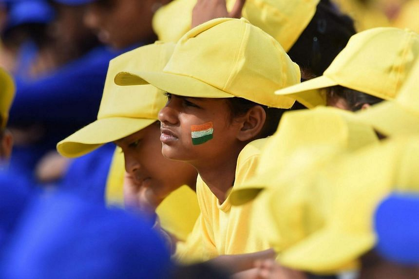Indian school children listen to Indian PM Narendra Modi's Independence Day speech from The Red Fort in New Delhi on August 15.