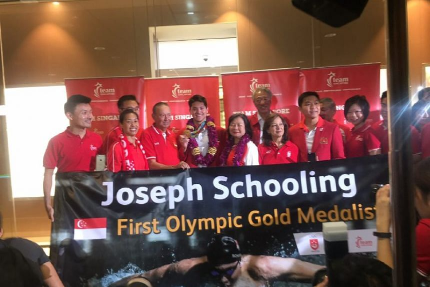 Joseph Schooling welcomed at Changi Airport on Aug 15.