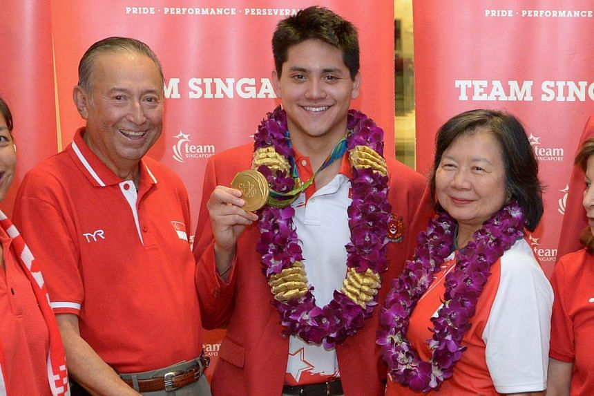 (From left) Mr Colin Schooling, Joseph Schooling and May Yim Schooling at Changi Airport on August 15.