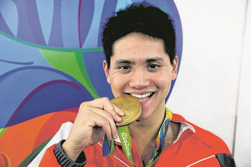 Joseph Schooling posing with his gold medal after winning the Rio 2016 Olympic Games men's 100m butterfly final, on August 12.
