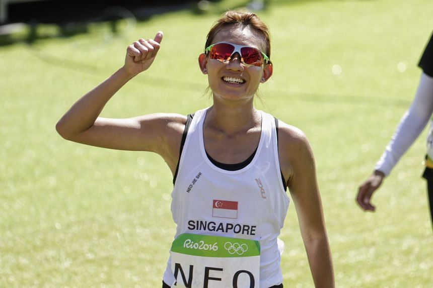 Singapore's Neo Jie Shi reacts after completing the marathon despite trying conditions.
