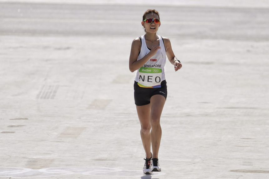 Singapore's Neo Jie Shi presses on to complete marathon despite trying conditions.