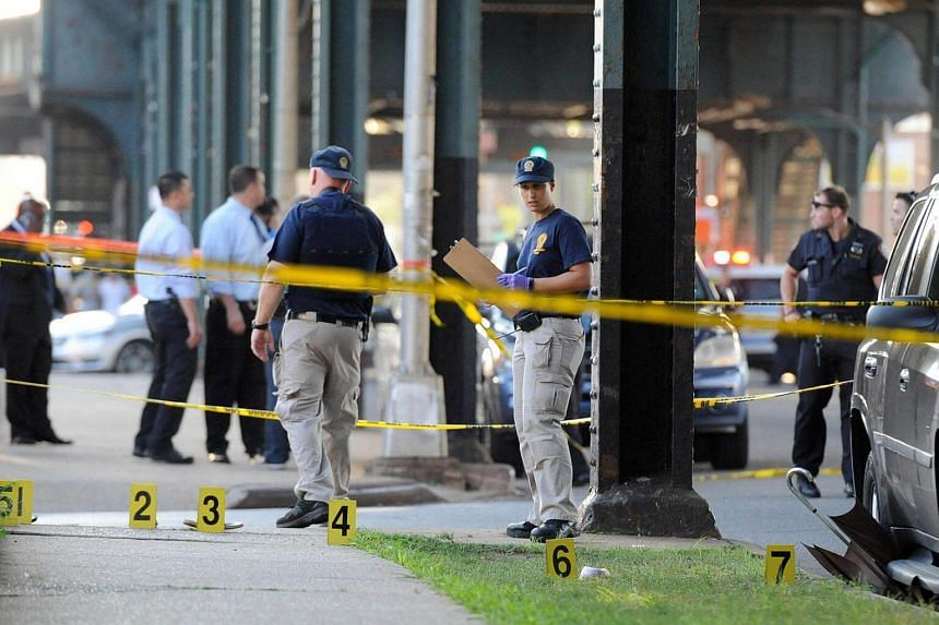 Members of the New York City Police Department at the scene where Imam Maulama Akonjee was killed, on August 13.