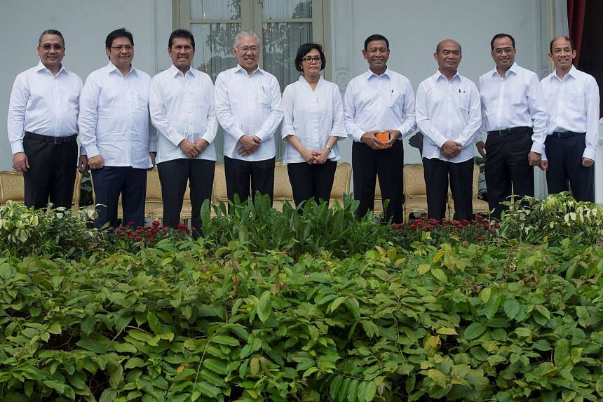 Sacked Indonesia Energy and Mining Minister Archandra Tahar poses with other cabinet members in July 2016.