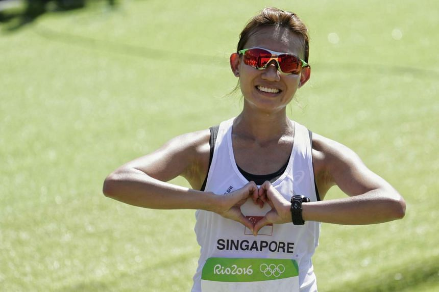 Singapore's Neo Jie Shi  makes a gesture of love to Singapore fans after completing the Rio 2016 Olympic Games women's marathon on Aug 14.