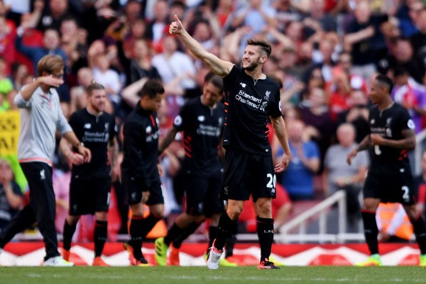 Liverpool's Adam Lallana celebrates after the match.