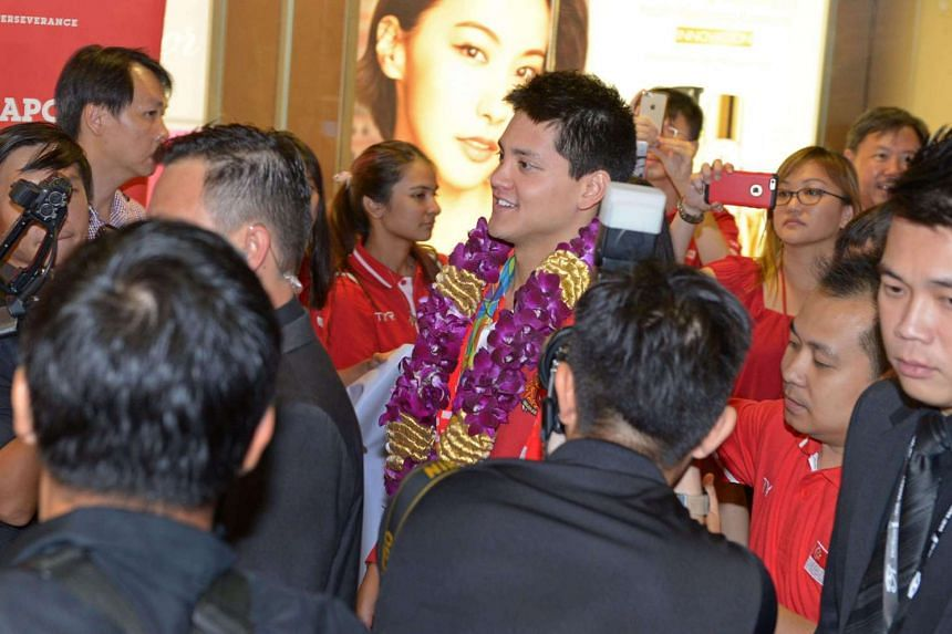 Joseph Schooling, Singapore's Olympic gold medallist, returns to Singapore from the Rio Olympics with his mother May Yim Schooling.