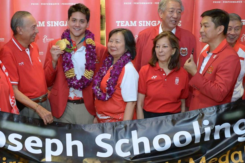 (From left) Colin Schooling, Joseph Schooling, May Yim Schooling, Annabel Pennefather, DPM Teo Chee Hean and Minister Tan Chuan Jin pose for a photograph.