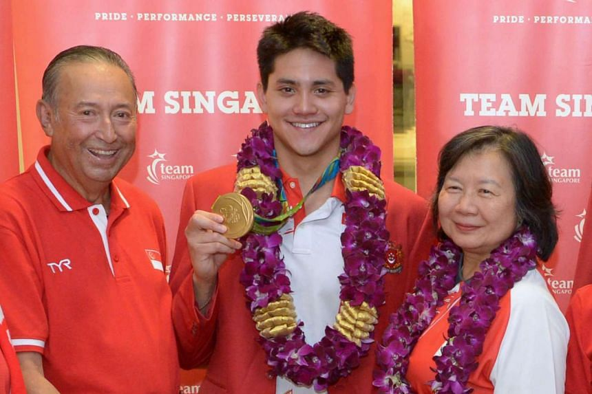 Joseph Schooling returns to Singapore from the Rio Olympics with his mother May Yim Schooling.
