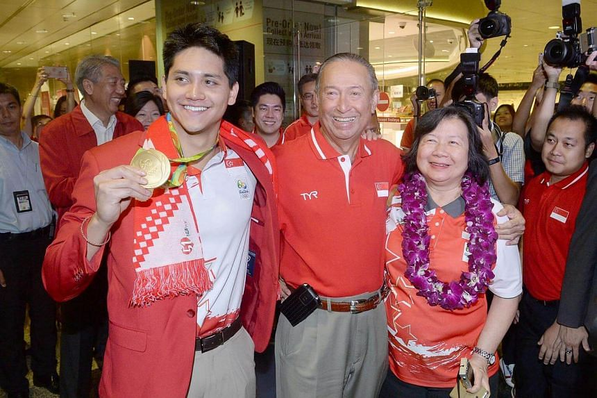 Singapore swimmer Joseph Schooling with his parents Colin and May Schooling.