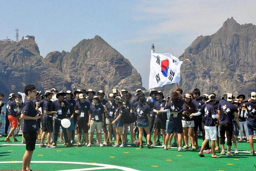 Visitors arriving at Takeshima/Dokdo islands, which have been the focus of a long dispute between Japan and Korea.