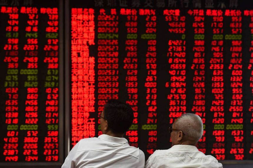 Investors monitor stock price movements at a securities company in Beijing on June 15, 2016.
