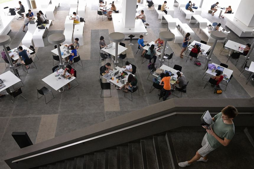 Students seen studying at an open space at the NUS U-Town campus.